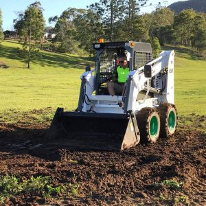 Wecan 650F Skid Steer driving on dirt.