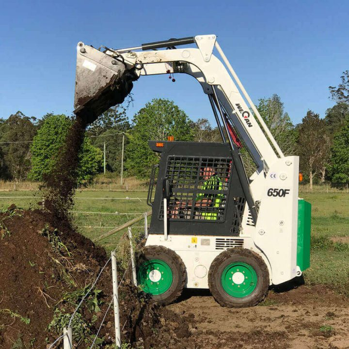 Wecan 650F Skid Steer in use dumping dirt.