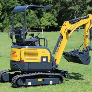 Carter CT16 Mini Excavator with Trailer on grass.