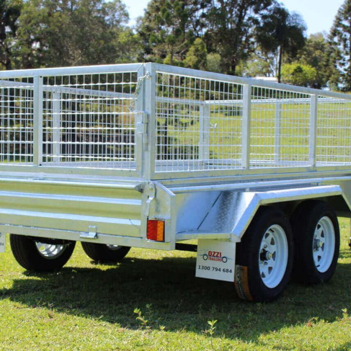 Ozzitrailer 10x5 Tandem Axle Box Trailer side view from back on grass.