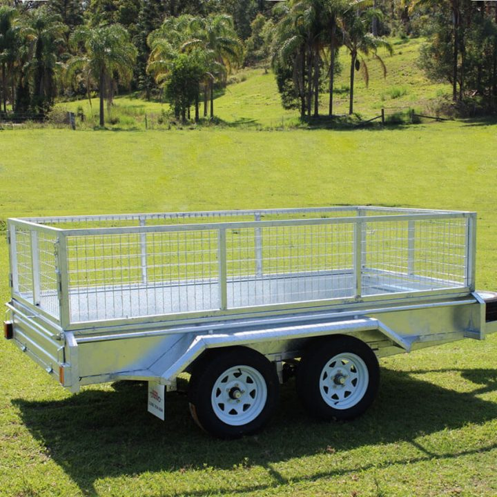 Ozzitrailer 10x5 Tandem Axle Box Trailer side view on grass.