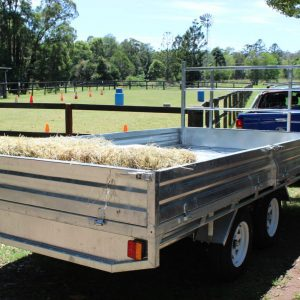 14x7 Flat Top Galvanised Trailer loaded with hay.