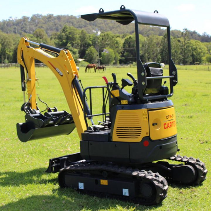 Carter Excavator CT16 side view on grass.