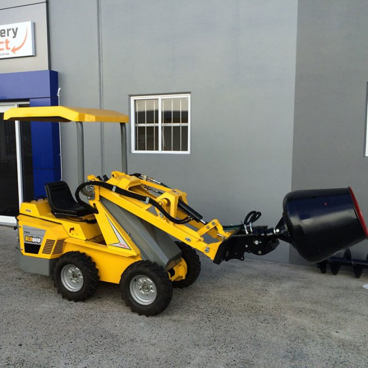 Ozziquip Puma Mini Loader Fencers with cement bucket.