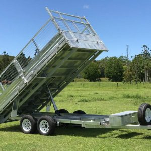 Ozzi Trailers 14x7 Flat Top Hydraulic Tipper with Ramps in tipping mode.
