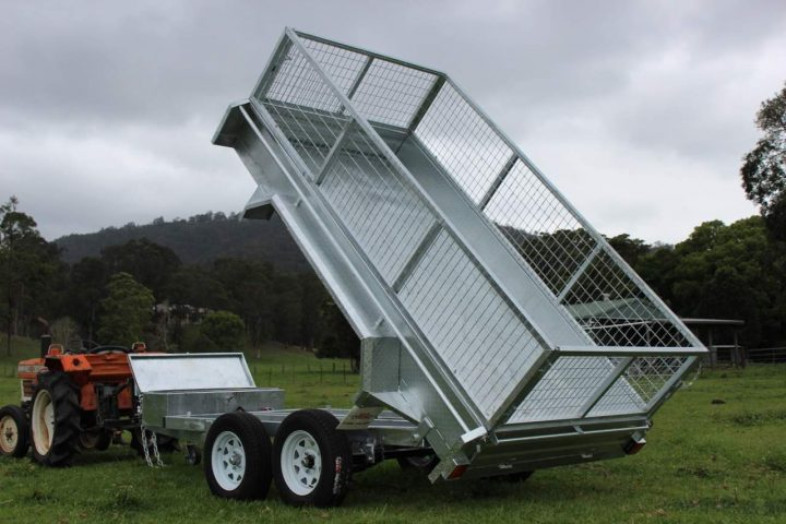 Flat top trailer in tipping mode.