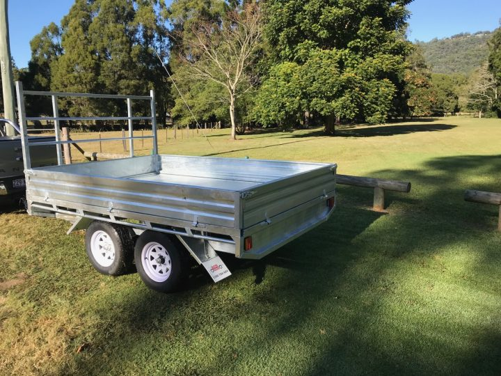 10x7 Flat Top Trailer back view on grass.