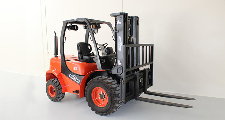Forklift in front of white wall.