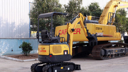 Mini excavator next to large excavator.