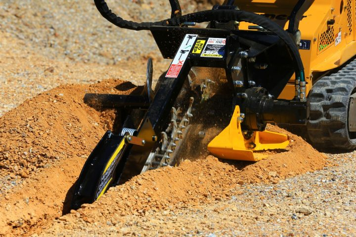 Digga Mini Bigfoot Trencher in use close up.
