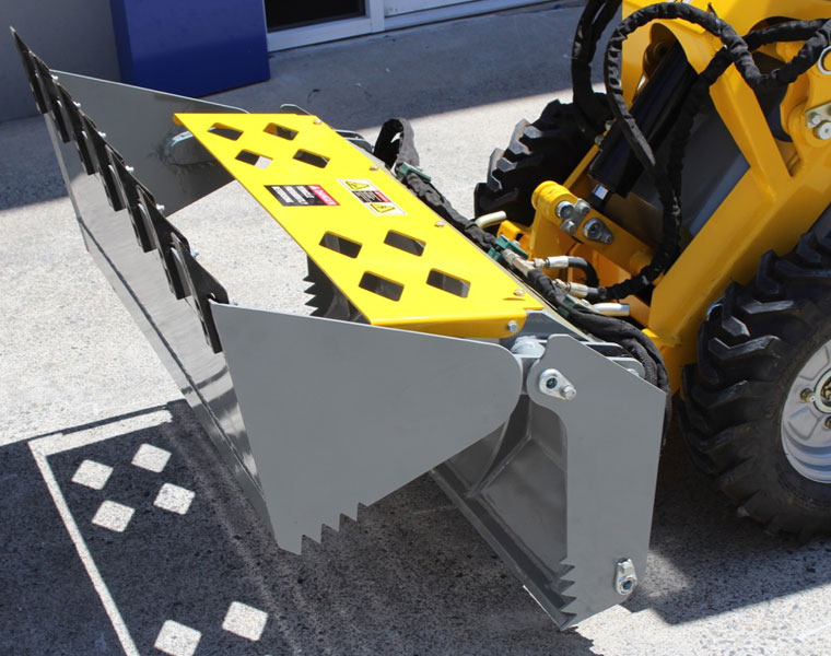 Ozziquip Puma Mini Loader bucket attached.