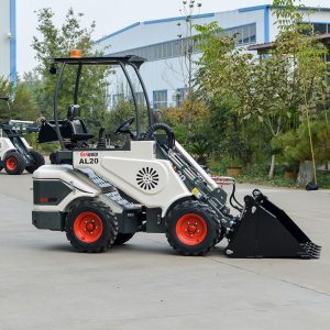 Ozziquip AL40 Mini Articulated Wheel Loader side with bucket on ground.