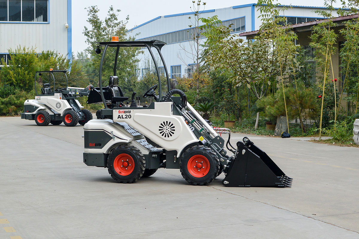 Ozziquip AL40 Mini Articulated Wheel Loader side with bucket on ground | Featured image for Equipment for Construction Projects: What Size is Best? | Blog