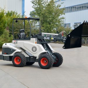 Ozziquip AL40 Mini Articulated Wheel Loader side view with bucket.